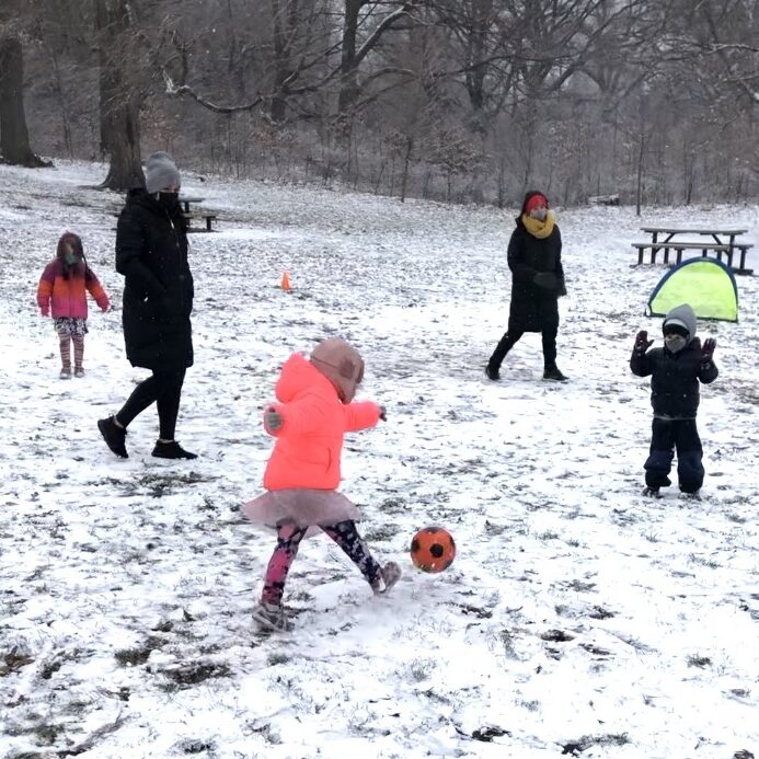 Children Playing Soccer in the Snow